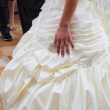 Wedding day. Hand of bride with a wedding ring on her dress — Stock Photo #39109077