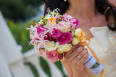 Bride and bouquet. Wedding Bouquet. Bouquet in the hands of the bride. Bride holding a wedding bouquet. — Stock Photo