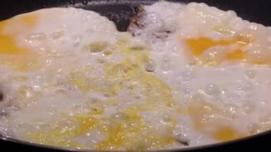 Poached egg. Fried Egg. Horizontal image of fried eggs in a pan. — Stock Video