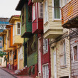 Colorful street scene with very narrow house painted. Historic houses in Istanbul, Fatich. — Stock Photo #44155123