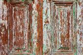 Rich Wood grain barn door with peeling paint texture. — Stock Photo
