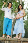 Young happy pregnat woman & her husband — Stock Photo