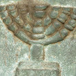 Jewish symbol on a ancient tombstone - Stock Photo