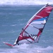 Windsurfing on a beach — Stock Photo