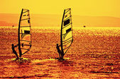 Two windsurfers — Stockfoto