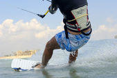 Kiteboarding on  a Mediterranean sea coast — Stock Photo