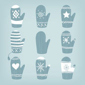 Set of blue Christmas mittens — Stock Vector