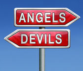 Angels and devils — Stock Photo