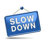Slowdown blue placard — Stock Photo
