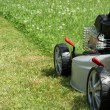 Stock Photo: Silver lawn mower.