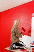Girl with paint roller. — Stock Photo
