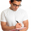 Student in glasses writes in book — Foto Stock #2490252