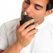 Man smelling aftershave cologne — Stock Photo #2530046