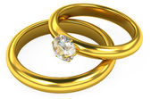 3d wedding gold rings on white background — Stock fotografie
