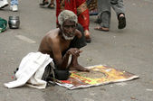 Old Indian man seek help  in the street — Stock Photo