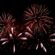 Explosions of green and red fireworks - Stockfoto