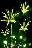 Green and yellow fireworks — Stock Photo