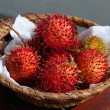 Basket of rambutan — Stock Photo