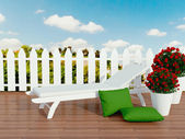 White sunlounger and roses. — Stock Photo