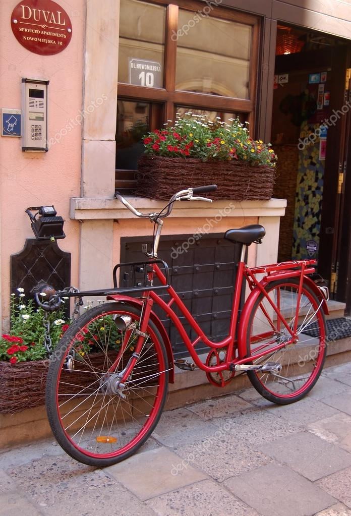 WARSAW, POLAND - MAY 25: Bicycle near the hotel entrance in Old Town on May 25, 2009 in Warsaw, Poland. This is part of the medieval city, which in XIII century occu  Stock Photo #13315753