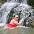 Woman swiming in a river — Stock Photo