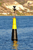 Channel marker in the sea channel — Stock Photo