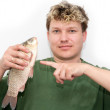 Stock Photo: A man with a fish on a white background