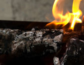 Fire, burning coal on a barbecue — Stock Photo
