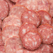 Sliced sausage as background — Stock Photo