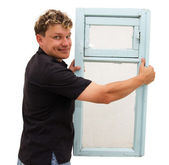 Man holding an old window on a white background — Stock Photo