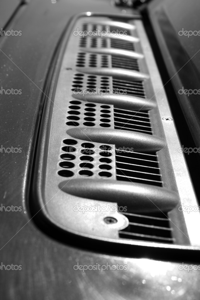 Grille on the hood of car — Stock Photo #15839939