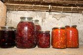 Canned jars on a shelf — Stock Photo