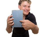 Man holding a book on a white background — Stock Photo