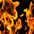 Stock Photo: Fire flames on a black background