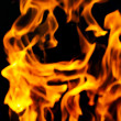 Fire flames on a black background — Stock Photo #37154177