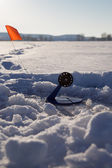 Fishing line in hole drilled in ice — Stock Photo