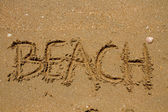 Beach text in the sand — Stock Photo