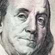 Benjamin Franklin face on dollar bill — Stock Photo