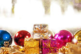 Christmas background with gifts and baubles — Stock Photo