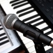 Microphone and piano keyboards — Stock Photo