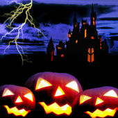 Castle and three pumpkins in night — Stock Photo