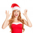Surprised christmas woman wearing a santa hat smiling isolated o — Stock Photo