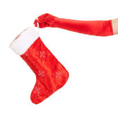 Vrouw hand met christmas stocking geïsoleerd over wit — Stockfoto