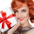 Stock Photo: Young happy woman with a gift. Isolated over white