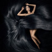Beautiful woman lying on the hair and cover her body — Stock Photo