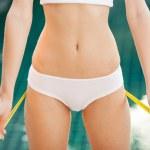 Woman measuring her waistline. Perfect Slim Body. Outdoor — Stock Photo #20191023