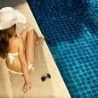 Royalty-Free Stock Photo: Beautiful woman sunbathing near swimming pool