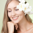Portrait of attractive woman with flower smiling — Stock Photo #20191099