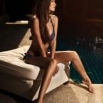 Beautiful tan woman in bikini sunbathing — Stock Photo #20191109