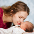 Picture of happy mother with baby in bedroom — Stock Photo